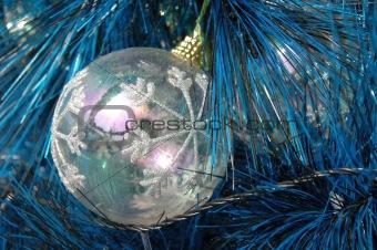 Transparent christmas ball on tree