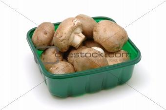 Close up of brown mushrooms in box