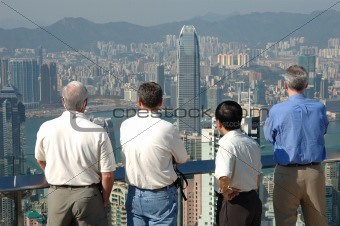 Four gentlemen looking at the commerical city