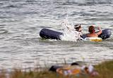 children on lake