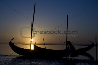 Moliceiro boat on sunset