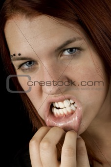 Aggressive girl showing her teeth