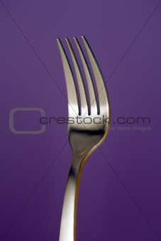 a fork against red background