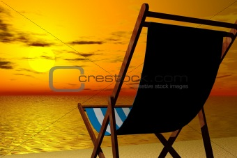 Beach chair at sunset