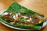 BBQ stingray on banana leaf