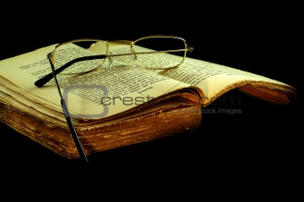 old book with a glasses