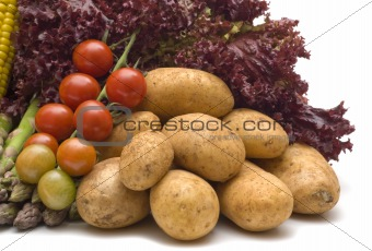 potatoes on vegetables background