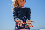 Young girl with sand covered hands