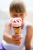Ice cream held by young girl