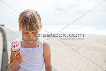 Girl with ice cream near beach