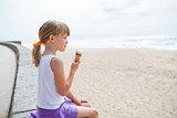 Girl with ice cream near beach