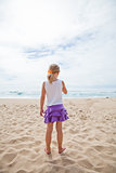 Young girl standing at beach