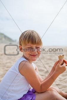 Happy girl with ice cream on beach
