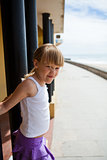 Young girl on beachside walkway