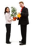 Happy couple watering plant