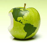 Green apple with earth map