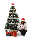 Opening Christmas presents near decorated tree