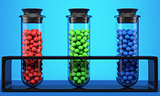 Test tubes with red, green and blue spheres