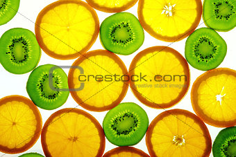 Green kiwi and orange slices
