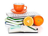 Orange fruits, coffee cup and office supplies