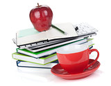 Red coffee cup, ripe apple and office supplies