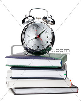 Alarm clock on notepads