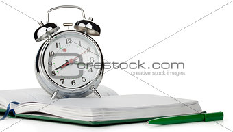 Alarm clock on notepad