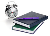 Alarm clock and two notepads