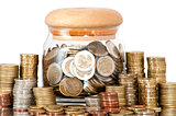 A jar full of coins on white background