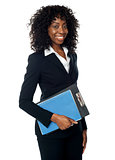 Black woman holding clipboard