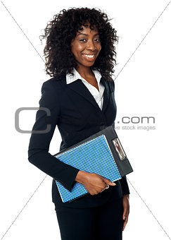 Black woman holding clipboard