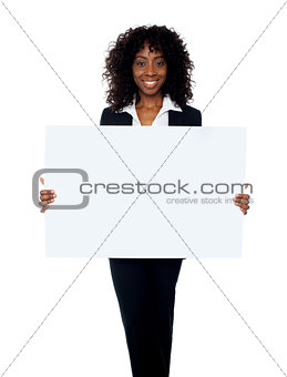 African woman showing billboard banner