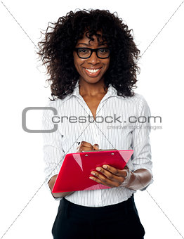 Beautiful business professional making notes
