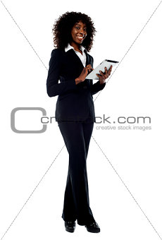 African woman operating touch pad device