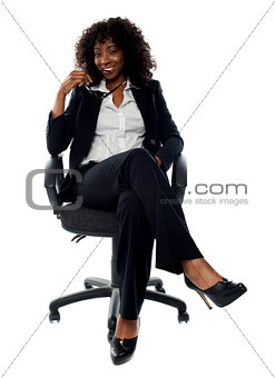 Corporate lady posing with eyeglasses in hand