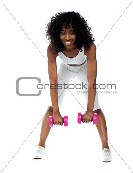 Fit woman exercising. Bending down