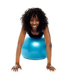 Fit african woman exercising