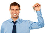 Portrait of smiling businessman holding keys