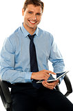 Relaxed businessman using tablet pc