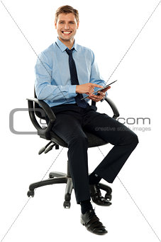 Corporate man working on touch pad device