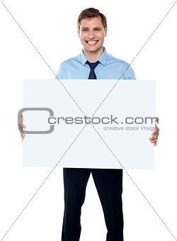 Corporate man showing billboard banner