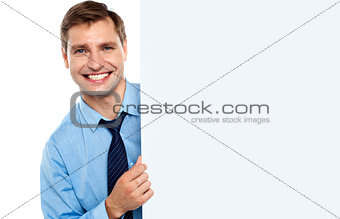 Business man holding a long blank banner ad