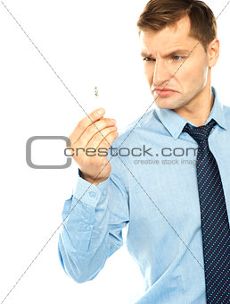 Angry smoker staring at cigarette