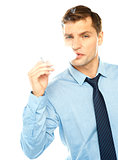 Young businessman smoking cigarette