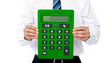 Closeup of a green calculator. Man holding it
