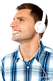 Young man tuned into music