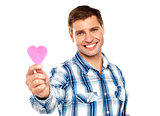 Man showing pink paper heart