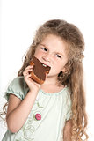 Little girl portrait eating chocolate spread