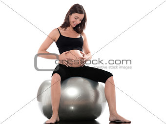 Pregnant Woman Happy sitting on swiss ball fitness