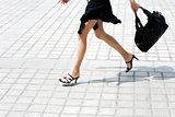 detail caucasian woman legs running in the street